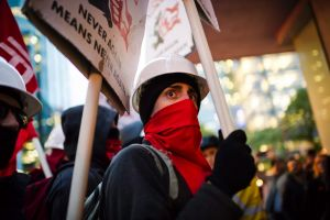 Protesters demonstrate prior to a Toronto Munk debate featuring former White House strategist Steve Bannon and ...