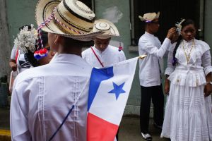 A group of students wearing Panama's traditional dress and hats, prepare before their independence day parade, in Panama ...