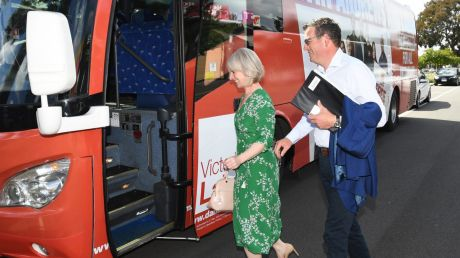 Victorian Premier Daniel Andrews and wife Catherine Andrews board the Labor bus.