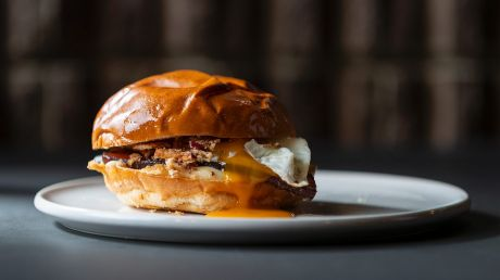 The egg and bacon roll with char sui bacon, egg, fried eschalot and kewpie mayonnaise.