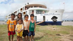 APT's AMALotus meets new friends on the Mekong River.
