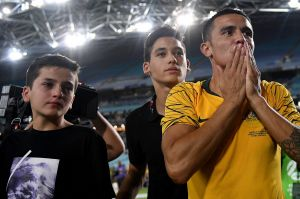 End of an era: Tim Cahill gestures to supporters following his final game.