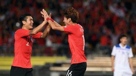 Hwang Ui-jo of Korea Rebublic  (right) celebrates after scoring a goal with Lee Yong (left)  during their win against ...