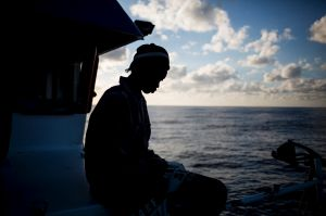 In this Friday, Nov. 30, 2018, photo, a migrant from Senegal sits on the deck of a the Nuestra Madre de Loreto Spanish ...