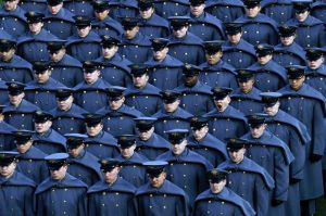 An Army cadet yawns after marching onto the field before an NCAA college football game against Navy, Saturday, Dec. 8, ...