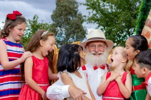Cliff White, centre, as the self-proclaimed Santa Claus in <i>Miracle on 34th Street Canberra</i>.