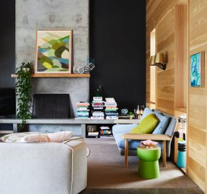 """""""I like to use colour to dial the mood within a room up and down,"""" says Julia. The print on the mantle is Wattle by ..."""