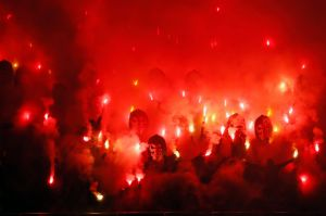 Paris Saint Germain's fans reacts with flares during the League One soccer match between and Nantes at the Parc des ...