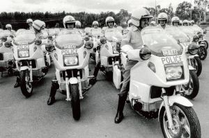 31st January 1985. Sergeant Steve Kirby of the Australian Federal Police Traffic Branch, Weston, leads a display group ...