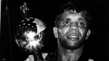 A weary eyed Lionel Rose clutches his world title trophy after beating Alan Rudkin in Melbourne 1969