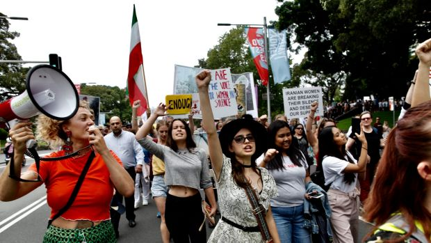 Photographs show scenes today from Sydney's Womens's March against violence that began in Hyde Park  and culminated ...