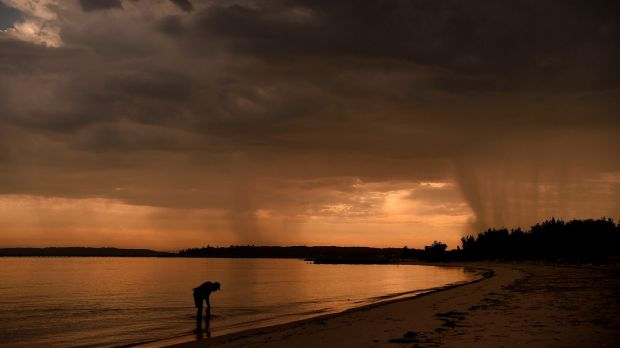 Dark clouds loom over Sydney's Botany Bay on Wednesday morning: fire risks are likely to be elevated across ...