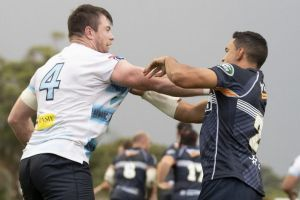 The Waratahs' Jed Holloway gets in the face of the Brumbies' Wharenui Hawera. Photo: Sitthixay Ditthavong