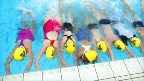Children should continue swimming lessons between age eight and 12 to achieve recommended skills.