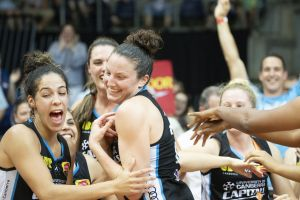 Canberra Capitals teammates cheer their co-captain Kelsey Griffin