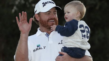 JB Holmes celebrates his Genesis Open victory with his son Tucker.