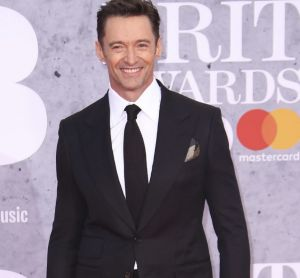 Actor Hugh Jackman poses for photographers upon arrival at the Brit Awards in London.