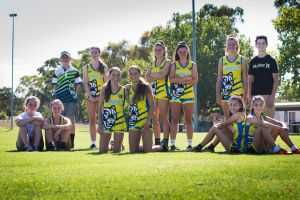 The under 15 girls Oztag team (with two of their brothers)  (front) Chloe and Nellie O'Donnell, Maddie and Ellie Hyland, ...