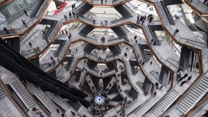 "Visitors to ""Vessel"" climb its staircases on its opening day at Hudson Yards, Friday, March 15, 2019, in New York. ..."