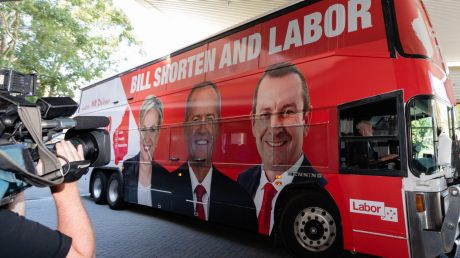 Bill Shorten arrives on his campaign bus – which bears the image of Premier Mark McGowan – before a visit to Royal Perth ...