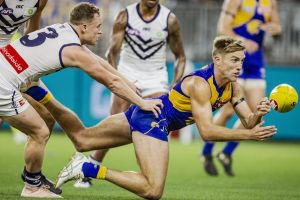 West Coast's Brad Sheppard gets a handball away in the round-four match against Fremantle.
