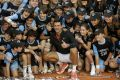 Novak Djokovic with the ball kids after winning the Madrid Open.