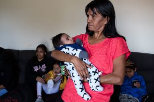 Lee-Anne Ebsworth with her grandson, Gordon, in the public housing home of her mother in Dubbo. Her family lived in the ...