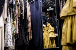 Jermal Nakia holds a dress once worn by Lady Ga Ga in the movie American Horror Story at the Sydney Fair.
