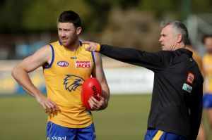West Coast Eagles coach Adam Simpson directs Jeremy McGovern during a training session.