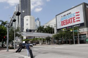 A billboard advertises the Democratic presidential debates across from the Knight Concert Hall at the Adrienne Arsht ...