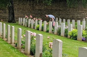 A gardener tends to the upkeep of war graves at the Faubourg D'amiens Cemetery in Arras.