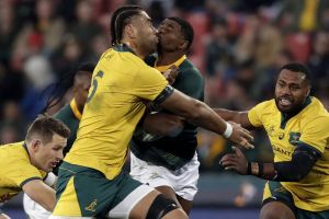 Defensive wall: South Africa's Warrick Gelant runs into Lukhan Salakaia-Loto at Ellis Park.