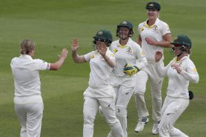 Australia celebrate the wicket of England's Anya Shrubsole, stumped by Alyssa Healy off Jess Molineux at Taunton on Sunday.
