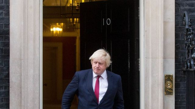 Boris Johnson, leaves after being named as U.K. foreign secretary, after a meeting with Theresa May, U.K. prime ...