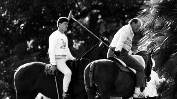 Like father like son .... Kerry Packer teaches his son, James, to play polo in March 1987.