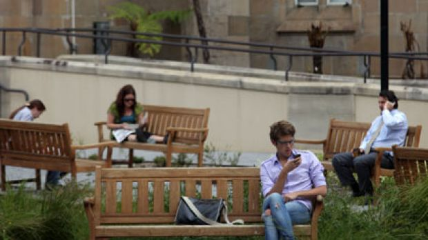 Calls of higher learning ... students relax between lectures yesterday at the University of Sydney, where disadvantaged ...