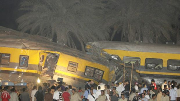 Scene of chaos ... bystanders gather at the scene of the crash 40 kilometres south of Cairo. Passengers were trapped in ...