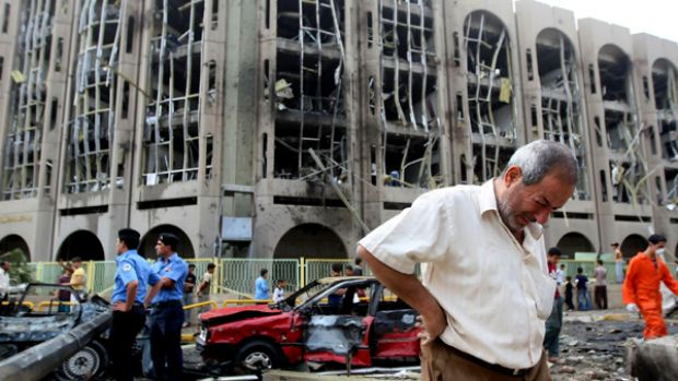 Slaughter ... an Iraqi weeps as rescuers search for survivors in the devastated Justice Ministry building.