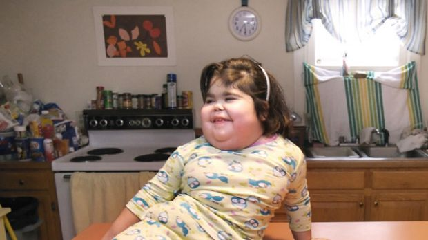 Shiloh Pepin laughs with her parents while sitting on a counter in the family's Kennebunkport, Maine home in 2007.