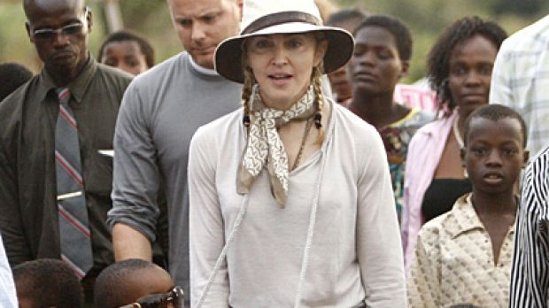 Madonna with her adopted children David and Mercy at the Mphandula Child Care Centre west of Lilongwe, Malawi, yesterday.
