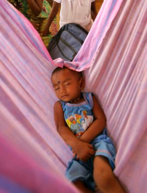 A Tamil child sleeps in a refugee camp in Sri Lanka. The conditions in these camps have been cited as a reason for the ...