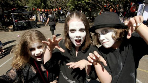 Every witch way... Stella, 7, with her cousin Laura, 10, and sister Audrey, 10, at Nicholson Street Public School's ...