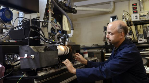 Kodak print head engineer Todd Griffin makes a demo print with a high speed drum at Kodak research labs.
