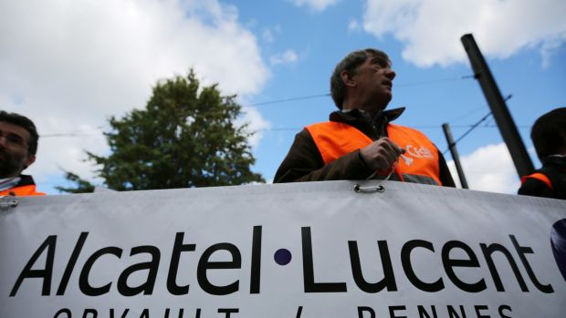 French workers protest against Alcatel-Lucent's cost-cutting plans.