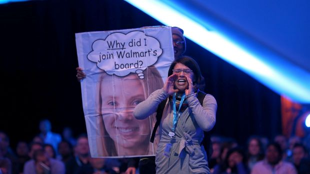 A protester shouts as Yahoo CEO Marissa Mayer speaks in conversation with Salesforce chairman and CEO Marc Benioff at ...