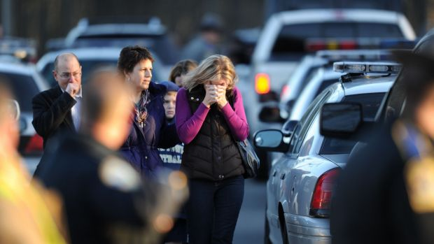 Turmoil: Residents grieve following the shooting at Sandy Hook Elementary School.