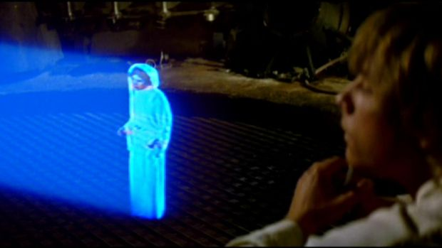 """Help me Obi Wan Kenobi"": Princess Leia leaves a 3D hologram message in <em>Star Wars</em>."