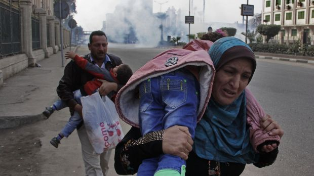 Violence: Family members run from tear-gas during a clash between security forces and Muslim Brotherhood supporters in ...