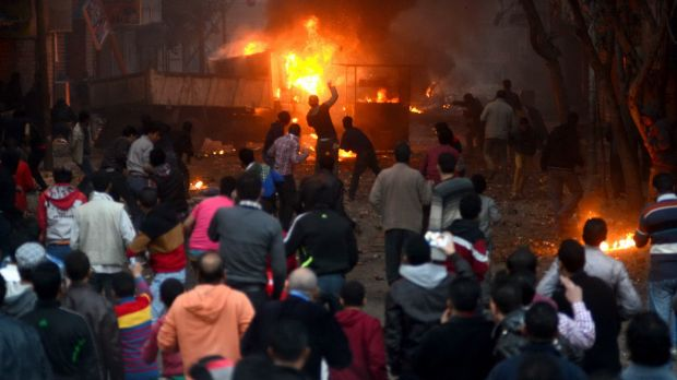 Referendum fallout: Angry Muslim Brotherhood supporters riot in Cairo on Friday.