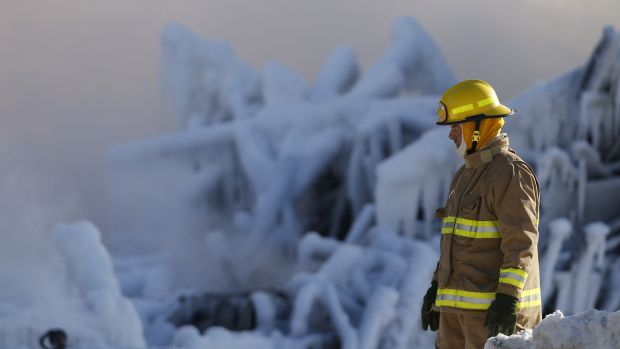 Aftermath: A firefighter surveys the damage at the Residence du Havre.